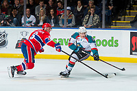 KELOWNA, CANADA - MARCH 3: Tyson Helgesen #6 of the Spokane Chiefs stick checks Marek Skvrne #9 of the Kelowna Rockets on March 3, 2018 at Prospera Place in Kelowna, British Columbia, Canada.  (Photo by Marissa Baecker/Shoot the Breeze)  *** Local Caption ***
