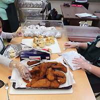 Adam Robison   BUY AT PHOTOS.DJOURNAL.COM<br /> Melody Texada, twelfth grade and Kaylee Ryan, tenth, students at Mooreville High School, prepare chicken biscuits in Audry Roby's classroom at Mooreville High School Tuesday morning.