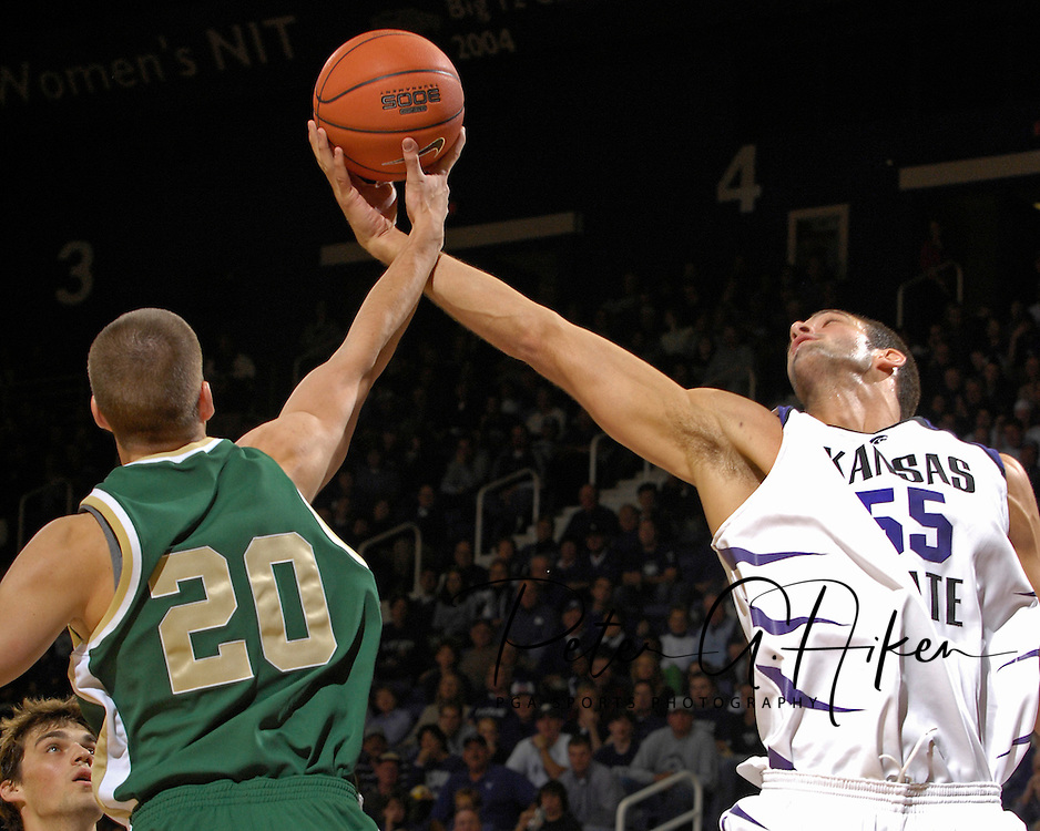 Kansas State center Jason Bennett (55) reaches for a rebound against William &amp; Mary guard Kyle Carrabine (20) in the second half at Bramlage Coliseum in Manhattan, Kansas, November 11, 2006.  K-State defeated the Tribe 70-60.<br />