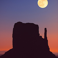 Moon rise over West Mitten Butte in Monument Valley.
