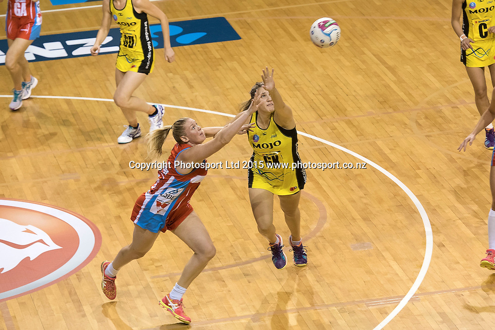Swifts' Caitlin Thwaites(L) jumps for the ball with Pulse's Te Huinga Reo Selby-Rickit during the ANZ Championship - Pulse v Swifts netball match at the TSB Arena in Wellington on Saturday the 25th of April 2015. Photo by Marty Melville / www.Photosport.co.nz