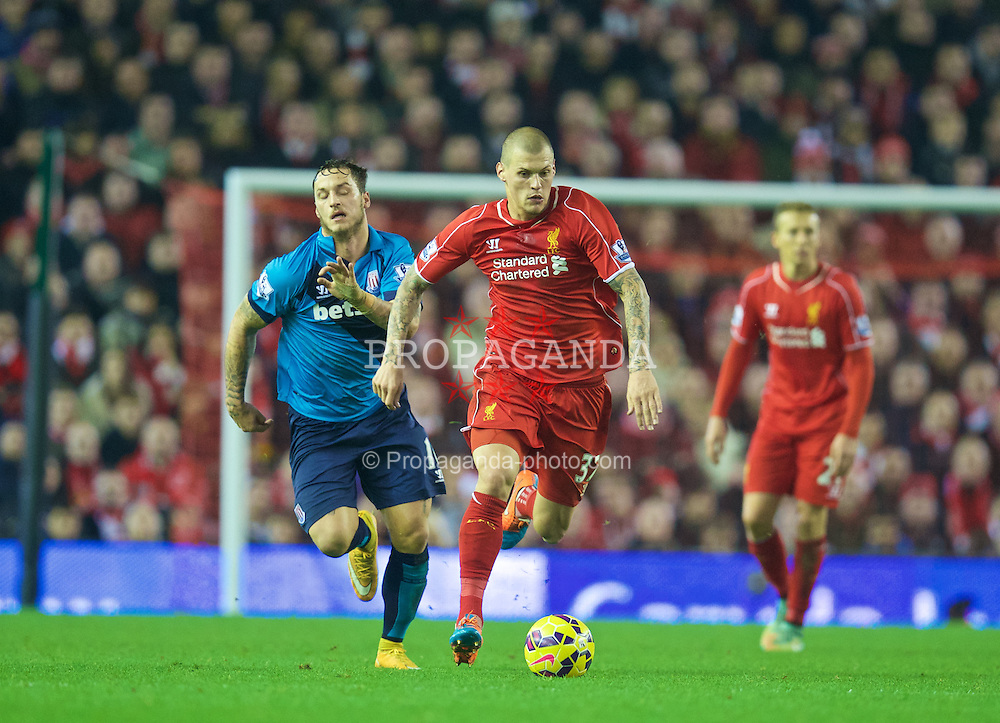 LIVERPOOL, ENGLAND - Saturday, November 29, 2014: Liverpool's Martin Skrtel in action against Stoke City during the Premier League match at Anfield. (Pic by David Rawcliffe/Propaganda)