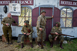 © Licensed to London News Pictures. 27/04/2018. Denmead, UK. Participants, dressed as American soldiers from the 101st Airbourne Division, take part in the Overlord Military Spectacular, a gathering of military re-enactors. The event, 1st held in 1977, is organised by The Solent Overlord Military Collectors Club and features some 200 military vehicles and 500 re-enactors dressed in authentic uniforms and equipment from the era.   Photo credit: Julian Herbert/LNP