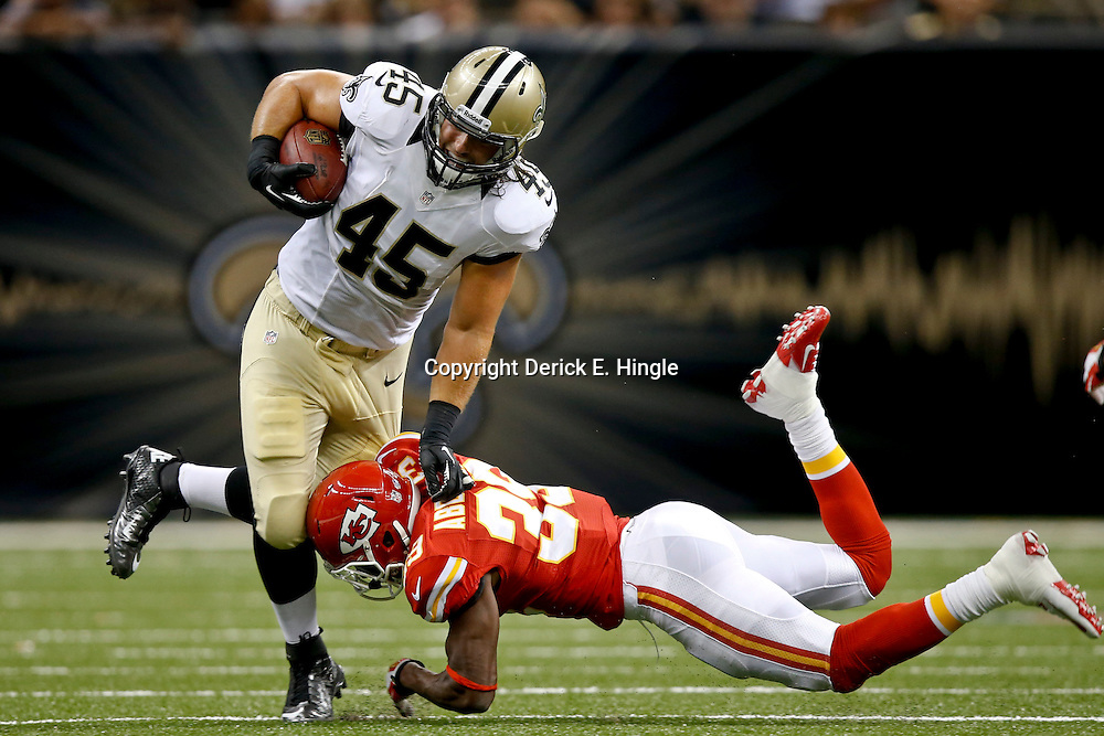 Aug 9, 2013; New Orleans, LA, USA; New Orleans Saints fullback Jed Collins (45) is tackled by Kansas City Chiefs defensive back Husain Abdullah (39) during the first quarter of a preseason game against the Kansas City Chiefs at the Mercedes-Benz Superdome. Mandatory Credit: Derick E. Hingle-USA TODAY Sports