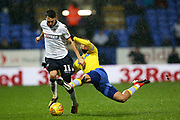 Leeds United midfielder Kemar Roofe (7) and Bolton Wanderers midfielder Will Buckley (11) during the EFL Sky Bet Championship match between Bolton Wanderers and Leeds United at the Macron Stadium, Bolton, England on 15 December 2018.