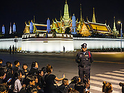 05 NOVEMBER 2016 - BANGKOK, THAILAND:  Thai police watch mourners at the end of the day  near the Grand Palace in Bangkok. Crowd of mourners continue to go to the palace to honor the King, Bhumibol Adulyadej, nearly three weeks after his death.    PHOTO BY JACK KURTZ