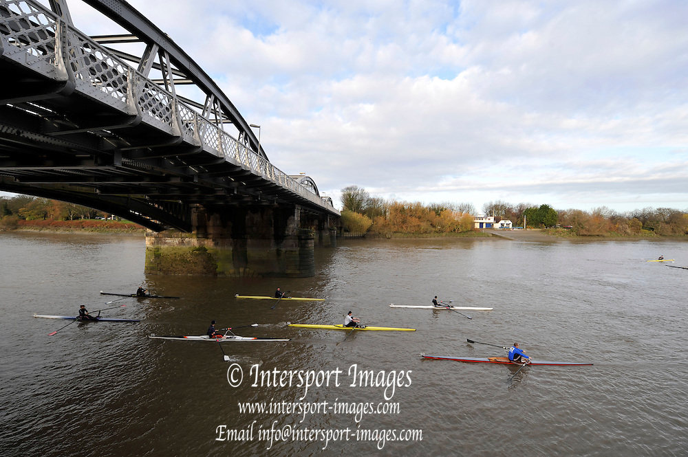 Chiswick, GREAT BRITAIN,   Scullers Marshalling for the 2011 Scullers Head of the River Race,  raced over the 'Championship Course', Mortlake to Putney, [Reverse], at the at Barnes Bridge, Dukes Meadows area.   River Thames.  Greater London, England.   Saturday  03/12/2011.  [Mandatory Credit, Peter Spurrier / Intersport-images