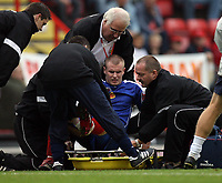 Photo: Rich Eaton.<br /> <br /> Bristol City v Crewe Alexander. Coca Cola League 1. 14/10/2006. Michael O'Connor of Crewe leaves the field on a stretcher