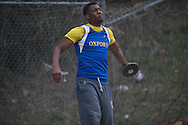 Oxford High's Darius Liggins throws the discus during the Oxford Eagle Invitational track meet at Oxford High School in Oxford, Miss. on Saturday, March 9, 2013.