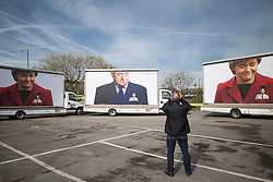 © Licensed to London News Pictures . 13/04/2015 . Manchester , UK . Conservative Party stunt opposite Old Granada Studios featuring ad vans with Ed Miliband depicted in the pockets of the SNP ahead of Ed Miliband launching the Labour Party manifesto ahead of the General Election at the Old Granada Studios in Manchester , UK . Photo credit : Joel Goodman/LNP