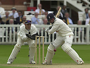 .Photo Peter Spurrier.Sport - Cricket.22/06/02.Bensen & Hedges Cup Final Lords Ground.Ian Bell lift hi sbat to play his shot with wicket keeper Andy Flower positioning himself.. [Mandatory Credit: Peter Spurrier:Intersport Images]