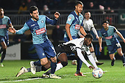 Coventry City striker Amadou Bakayoko (21) takes a tumble in the box under pressure from Wycombe Wanderers defender Joe Jacobson (3) during the EFL Sky Bet League 1 match between Wycombe Wanderers and Coventry City at Adams Park, High Wycombe, England on 29 December 2019.