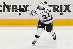 Dec 23, 2011; San Jose, CA, USA; Los Angeles Kings defenseman Willie Mitchell (33) warms up before the game against the San Jose Sharks at HP Pavilion. San Jose defeated Los Angeles 2-1 in shootouts. Mandatory Credit: Jason O. Watson-US PRESSWIRE