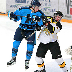 AURORA, ON - Jan 18 : Ontario Junior Hockey League Game Action between the St. Michael's Buzzers and the Aurora Tigers, Jake Evans #17 of the St.Michael's Buzzers Hockey Club tries to leap past Austin Rigney #7 of the Aurora Tigers Hockey Club.<br /> (Photo by Brian Watts / OJHL Images)