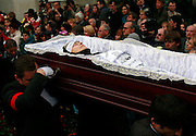 The body of Russian journalist Anna Politkovskaya files pass mourners. She was murdered in Moscow on 7 October, 2006. She was shot four times, once in the head, in an elevator in her apartment block. .The funeral, held in the Troyekurovskoye cemetery in western Moscow, was conducted by an Orthodox priest. Before the burial, thousands of well-wishers filed passed her body..Known for her critical coverage of the war in Chechnya and of Russian President Vladimir Putin, her murder is widely believed to be connected to her investigative work..The 48-year-old was a tireless reporter who had written a critical book on Russian President Vladimir Putin and his campaign in Chechnya, documenting widespread abuse of civilians by government troops..She leaves behind a son, a daughter and an ex-husband.