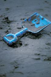 Childs toy blue sand shovel on beach at shore, Stone Harbor, NJ.