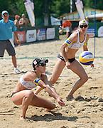 STARE JABLONKI POLAND - July 3:  Doris Schwaiger /1/ and Stefanie Schwaiger of Austria in action during Day 3 of the FIVB Beach Volleyball World Championships on July 3, 2013 in Stare Jablonki Poland.  (Photo by Piotr Hawalej)