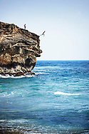 Cliff jumping at Ship Rock in Poipu, Kauai.