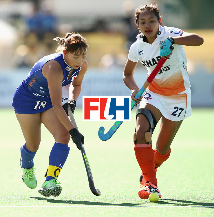 JOHANNESBURG, SOUTH AFRICA - JULY 20: Yukari Mano of Japan and Sushila Pukhrambam of India battle for possession during the 5th-8th Place playoff match between India and Japan during Day 7 of the FIH Hockey World League - Women's Semi Finals on July 20, 2017 in Johannesburg, South Africa.  (Photo by Jan Kruger/Getty Images for FIH)