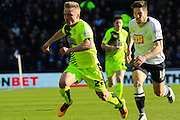 Huddersfield Town midfielder Kyle Dempsey is caught by Derby County midfielder Jacob Butterfield during the Sky Bet Championship match between Derby County and Huddersfield Town at the iPro Stadium, Derby, England on 5 March 2016. Photo by Aaron Lupton.