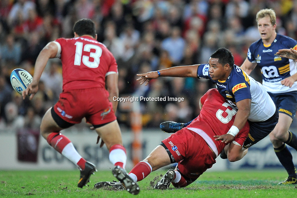 Ita Vaea gets his pass away in the tackle of James Slipper during action from Super 15 rugby (Round 16) - Reds v Brumbies played at Suncorp Stadium, Brisbane, Australia on Saturday 4th May 2011 ~ Photo : Steven Hight (AURA Images) / Photosport
