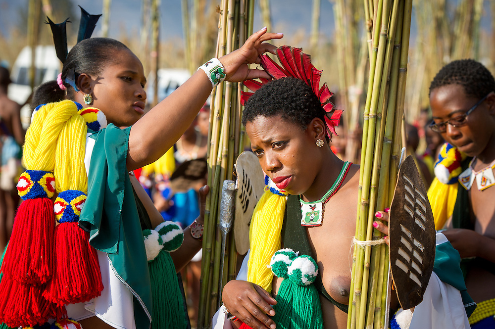 Ludzidzini, Swaziland, Africa - Annual Umhlanga, or reed dance ceremony, in which up to 100,000 young Swazi women gather to celebrate their virginity and honor the queen mother during the 8 day long event.<br /> Adjusting feather crown of princess