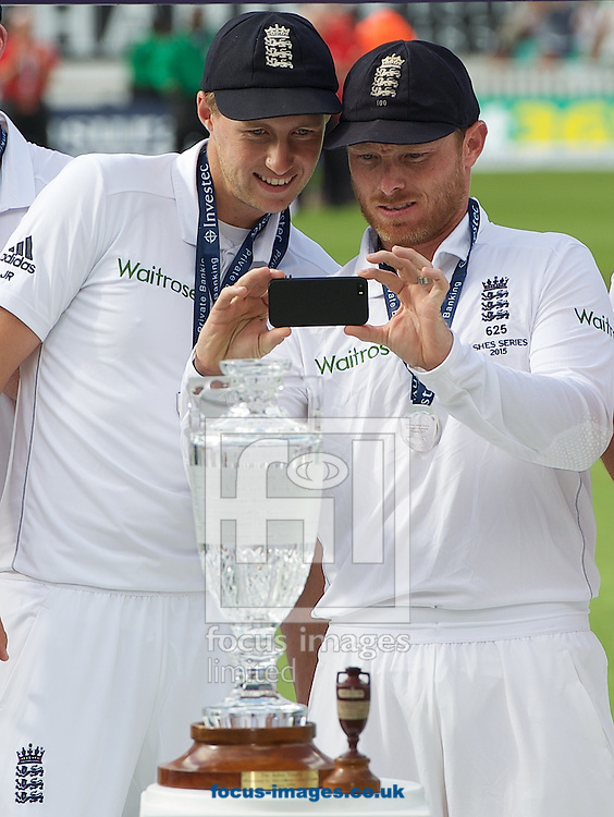 Ian Bell (right) and Joe Root of England take a picture of the Trophies on their mobile phones during the 5th Investec Ashes Test match at the Kia Oval, London<br /> Picture by Alan Stanford/Focus Images Ltd +44 7915 056117<br /> 23/08/2015