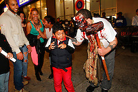 The scene in front of Blood Manor on Varick Street on October 14, 20.In this shot Ethen Mendez center and Ervin Moran on right being scared on the street. They didn't make it through the entire Blood Manor experience had to be removed early.  Release on file.