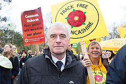 © Licensed to London News Pictures. 29/11/2015. London, UK. JOHN MCDONNELL joins protesters to take part in the People's March for Climate, Justice and Jobs in central London. Marchers are calling for world leaders take further measures to combat climate change and environmental issues. Demonstrations are taking place around the globe today to demand United Nations action against climate change, calling on world leaders to cease political posturing and commit to a concrete international plan for people affected by climate change at the UN Paris Climate Change Summit. Photo credit : Vickie Flores/LNP