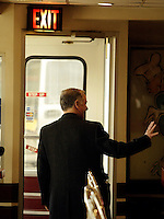 Democratic presidential hopeful Howard Dean, waves goodbye as he leaves Miss Katies Diner on a campaign stop to head to a press conference in Milwaukee WI. 11, Feb. 2004 MilwaukeeWI.    EPA -Darren Hauck.