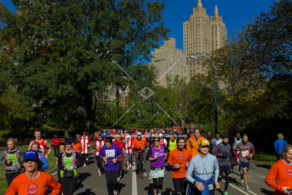 Despite the New York City Marathon being cancelled due to Hurricane Sandy, thousands of runners still came out to run in Central Park.<br /> <br /> Photo by Robert Caplin