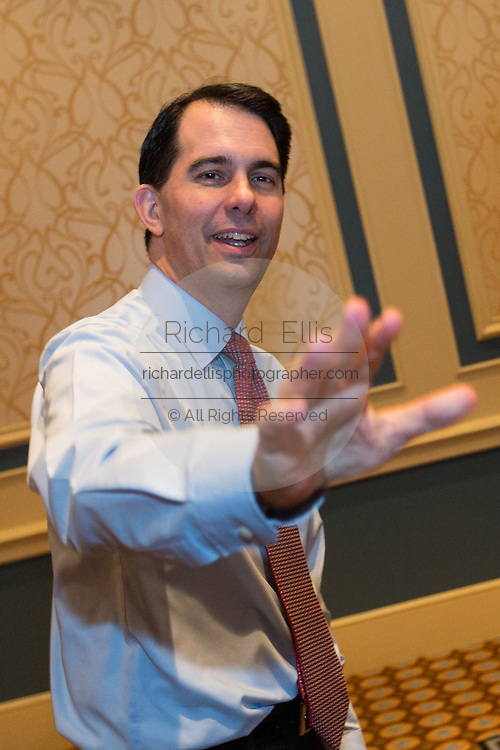 Wisconsin Governor and potential Republican presidential candidate Scott Walker waves to supporters during a GOP lunch event March 20, 2015 in Charleston, South Carolina.