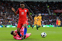 Raheem Sterling of England is challenged by Mat Ryan of Australia  - Mandatory by-line: Matt McNulty/JMP - 27/05/2016 - FOOTBALL - Stadium of Light - Sunderland, United Kingdom - England v Australia - International Friendly