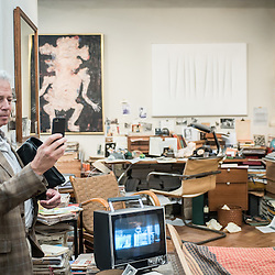 London, UK - 15 October 2014: a man takes a picture to the installation of an imaginary collector's apartment in Paris in 1968 curated by Helly Nahmad during the first day of Frieze Art Fair and Frieze Masters in Regent's Park.