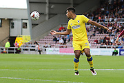 AFC Wimbledon striker Lyle Taylor (33) in action during the EFL Sky Bet League 1 match between Northampton Town and AFC Wimbledon at Sixfields Stadium, Northampton, England on 20 August 2016. Photo by Stuart Butcher.