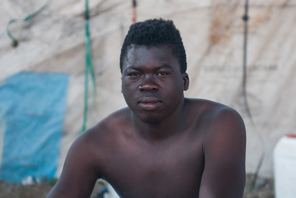 A migrant from Mali poses for a portrait on August 03, 2017 in Crotone, Italy. The city of Crotone hosts one of the biggest european centre for migrants, but some of them live in clandestinity, even for two years, in an area near the city railway station, because they are afraid to be rejected and to be sent to their nations again. ©Simone Padovani