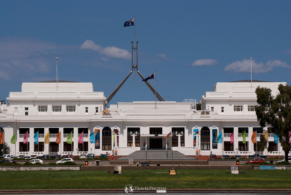Australia's Old Parliament House, and Museum of Australian Democracy, with the iconic flag pole of new Parliament House in the background