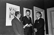 17/06/1963.06/17/1963.17 June 1963.1963 Irish Packaging Competition, reception at the Shelbourne Hotel. The Irish Packaging Institute aimed to raise the standard of packing design and business graphic design in Ireland and held competitions to encourage designers and to aid Irish industry..The 1963 award was sponsored by Hely-Thom Ltd. and named the Hely-Thom Perpetual Award.  Pictured are (l-r) Mr. E.G.O. Ridgwell, General Manager, Irish Packaging Institute, Mr. Michael Hilliar, designer of the award and Mr. Walsh, Coras Trachtala.