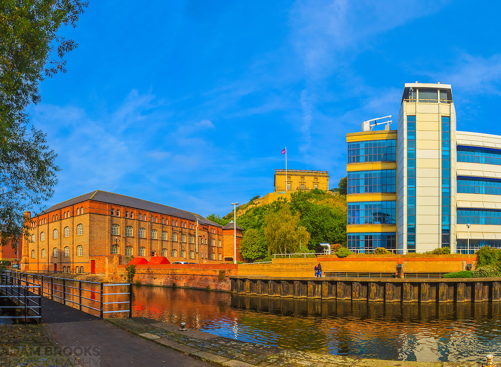Nottingham Castle flanked by Castle Court and the New Castle Building, with the Nottingham-Beeston canal in the foreground