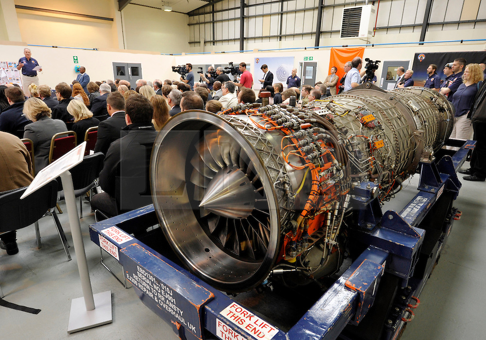 © Licensed to London News Pictures. 04/07/2013. Bristol, UK.  A Rolls-Royce EJ200 jet engine at the Bloodhound Supersonic Car project at the official opening of the new technical centre in Avonmouth, Bristol.  The car is being built to go at 1000mph to break the land speed record, powered by a rocket and a Rolls Royce EJ200 jet engine with a Cosworth engine being used as a pump.  The record attempt will take place in South Africa and Bloodhound will be piloted by Wing Commander Andy Green from the RAF.  David Willetts, Minister for Science and Universities, took part in joining parts of the bodywork together.  04 July 2013.<br /> Photo credit : Simon Chapman/LNP