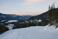 A panorama of the Whistler Valley, taken near sunset on a winter evening, shows Rainbow Mountain in the back.