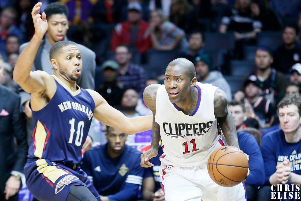 10 January 2016: Los Angeles Clippers guard Jamal Crawford (11) drives past New Orleans Pelicans guard Eric Gordon (10) during the Los Angeles Clippers 114-111 overtime victory over the New Orleans Pelicans, at the Staples Center, Los Angeles, California, USA.