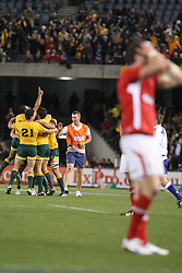 © Licensed to London News Pictures. 16/06/2012. Etihad Stadium, Melbourne Australia. Australian players celebrate after their after the siren win as a Welsh player has his hands on his head after the narrow defeat during the 2nd Rugby Test between Australia Wallabies Vs Wales . Photo credit : Asanka Brendon Ratnayake/LNP