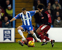 Photo: Olly Greenwood.<br />Colchester United v Stoke City. Coca Cola Championship. 16/12/2006. Colchester's Jamie Cureton takled by Stoke's Lee Hendrie