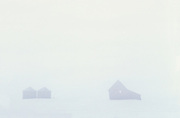 Old house and grain bins in whIteout <br /> Elma<br /> Manitoba<br /> Canada