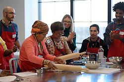 Teela Magar and Cing Neam prepare the roti dough. (photo by Bastiaan Slabbers)