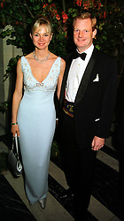 The EARL & COUNTESS OF DERBY at a dinner in London on 21st October 1999.MYA 120