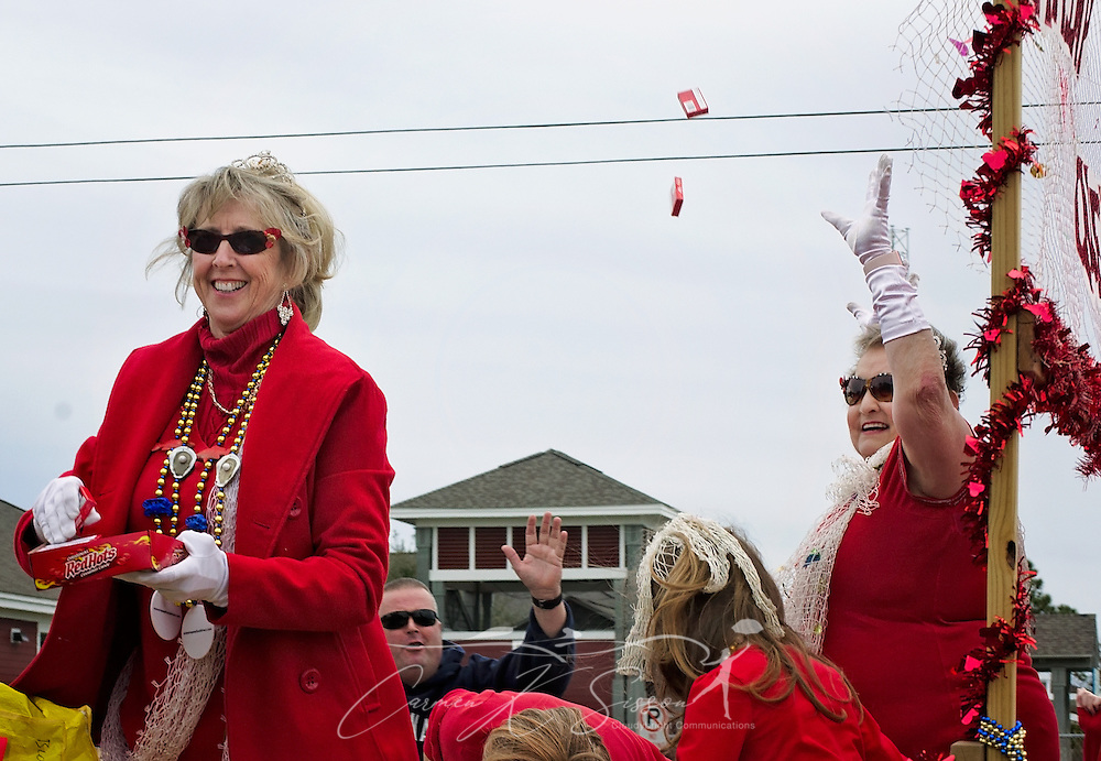 Members of the Organized Seafood Association of Alabama (Eat Alabama Wild Seafood) throw boxes of Red Hots candy during the Krewe de la Dauphine Mardi Gras Parade, Jan. 28, 2017, in Dauphin Island, Alabama. The organization promotes the understanding and marketing of the local seafood industry. (Photo by Carmen K. Sisson/Cloudybright)