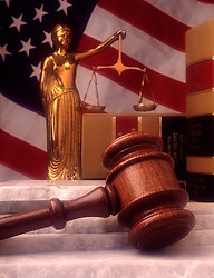 Brass statue blind justice with scales judges court gavel law books reference granite stone steps US USA American flag law legal system