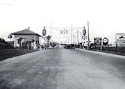 Fascist Italy during the 1920's and 1930's saw many large scale construction endeavours including highways and roads. Entrance to the Motorway 'Autostrada' at Milan Circa 1929